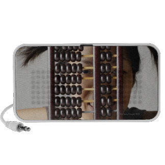 Young woman peering through abacus. portable speaker