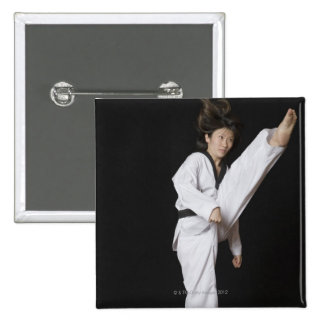 Young woman performing front kick 15 cm square badge