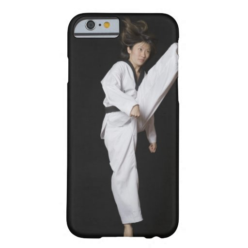 Young woman performing front kick iPhone 6 case