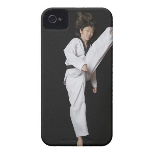 Young woman performing front kick iPhone 4 covers
