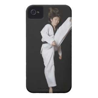 Young woman performing front kick iPhone 4 case