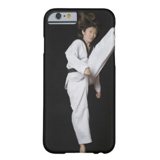 Young woman performing front kick barely there iPhone 6 case