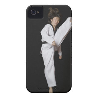 Young woman performing front kick iPhone 4 Case-Mate cases