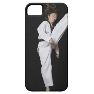 Young woman performing front kick iPhone 5 covers