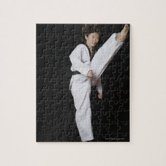 Young woman performing front kick jigsaw puzzle