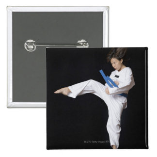 Young woman performing round kick 15 cm square badge