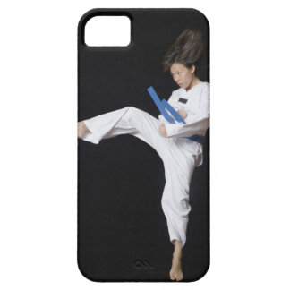 Young woman performing round kick barely there iPhone 5 case