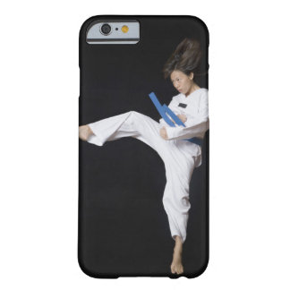 Young woman performing round kick barely there iPhone 6 case