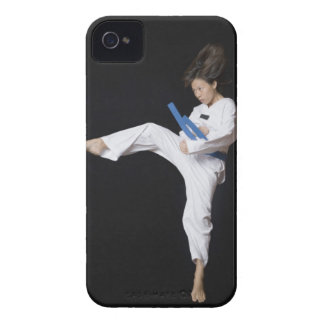 Young woman performing round kick iPhone 4 case