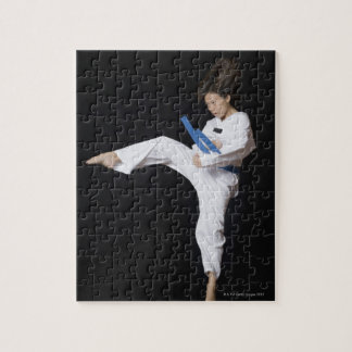 Young woman performing round kick jigsaw puzzle