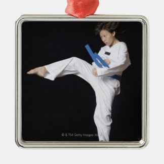 Young woman performing round kick Silver-Colored square decoration
