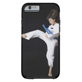 Young woman performing round kick tough iPhone 6 case
