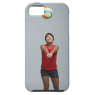 Young woman playing with volleyball case for the iPhone 5