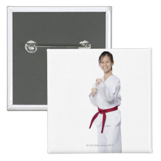 Young woman practicing karate and smiling 15 cm square badge