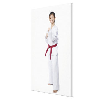 Young woman practicing karate and smiling canvas print