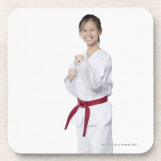 Young woman practicing karate and smiling coaster