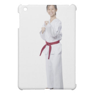Young woman practicing karate and smiling cover for the iPad mini