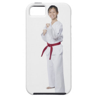 Young woman practicing karate and smiling iPhone 5 covers
