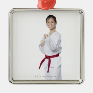 Young woman practicing karate and smiling Silver-Colored square decoration
