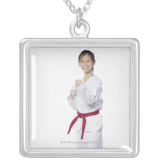 Young woman practicing karate and smiling silver plated necklace