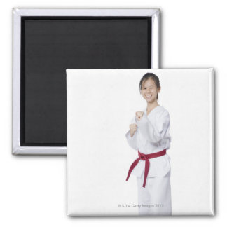 Young woman practicing karate and smiling square magnet