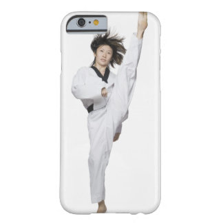 Young woman practicing kicking barely there iPhone 6 case