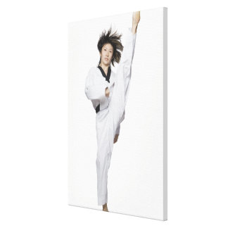 Young woman practicing kicking canvas print