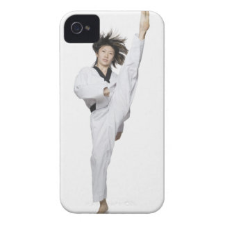 Young woman practicing kicking iPhone 4 Case-Mate cases