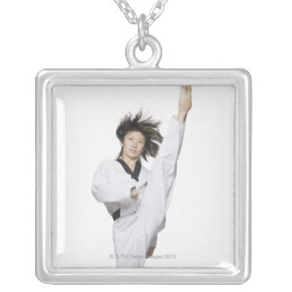 Young woman practicing kicking silver plated necklace