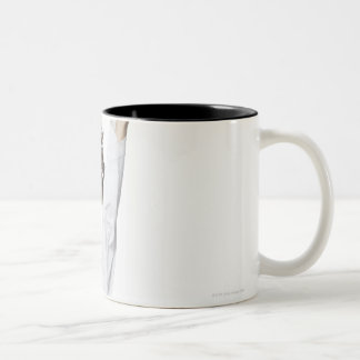 Young woman practicing kicking Two-Tone coffee mug