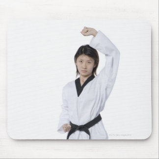 Young woman practicing upper block mouse mat