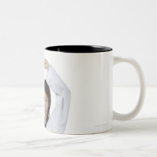 Young woman practicing upper block Two-Tone coffee mug