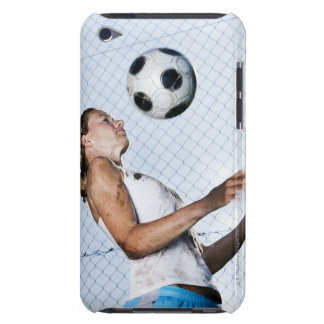 young woman practising with football barely there iPod case