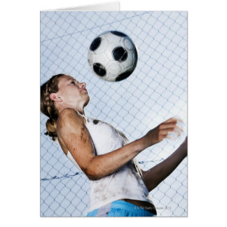 young woman practising with football greeting card