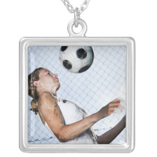 young woman practising with football silver plated necklace