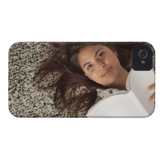 Young woman reading a book lying down Case-Mate iPhone 4 case