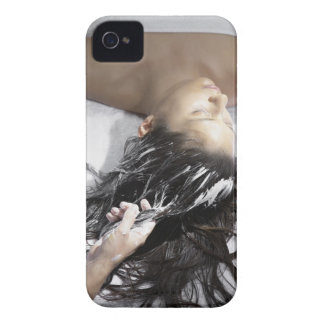 Young woman receiving hair treatment iPhone 4 cases