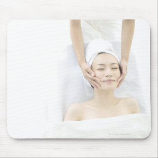 young woman receiving massage,woman in health mouse mat