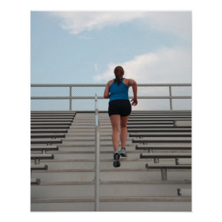 young woman running up steps poster