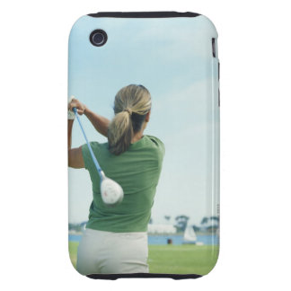 Young woman swinging golf club, rear view tough iPhone 3 cases