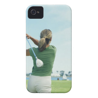 Young woman swinging golf club, rear view iPhone 4 Case-Mate case