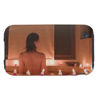 Young woman taking bath with flower petals iPhone 3 tough covers