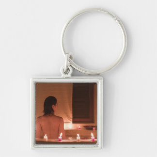 Young woman taking bath with flower petals Silver-Colored square key ring
