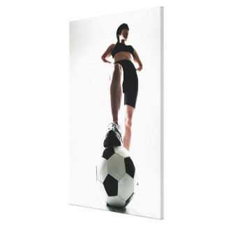 young woman training,football canvas print
