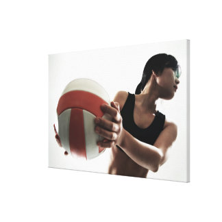 young woman training,volleyball canvas print