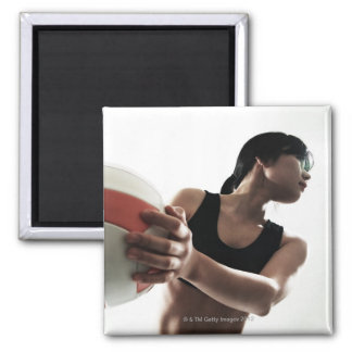 young woman training,volleyball magnet