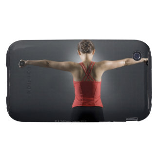 Young woman using dumbbells, rear view, studio tough iPhone 3 cases