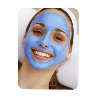 Young woman wearing facial mask, smiling, flexible magnet