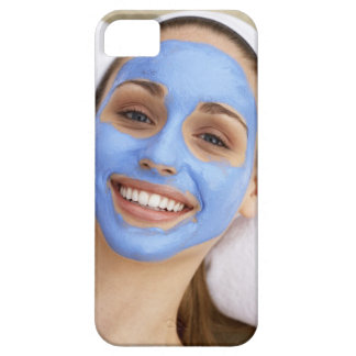 Young woman wearing facial mask, smiling, iPhone 5 cases