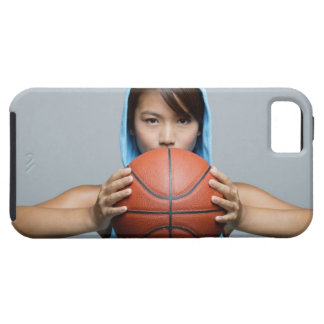 Young woman with basketball looking at camera iPhone 5 covers